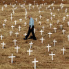 A man walks through a field of crosses erected near Pretoria, South Africa, to honour mostly white farmers who have died in. farm attacks. Reuters/Juda Ngwenya